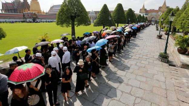 Thai mourners line the streets for the king's funeral procession