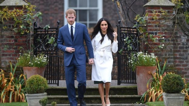 Prince Harry and Meghan Markle outside Kensington Palace
