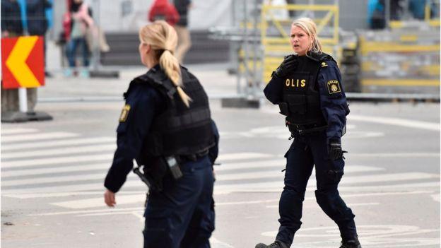 Swedish police work on the scene