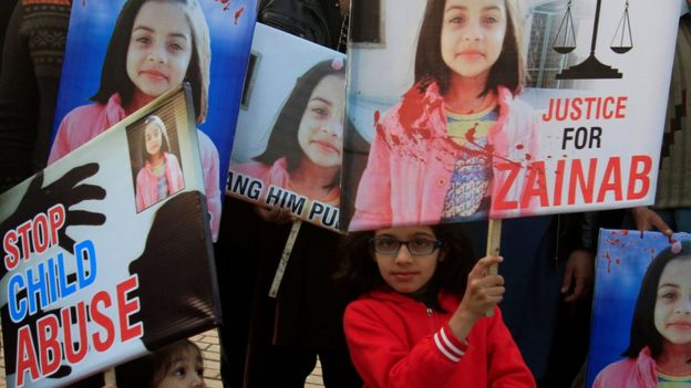 A girl holds a sign as she chants slogans with others to condemn the rape and killing of Zainab Ansari in Kasur, during a protest in Lahore, Pakistan on 14 January 2018