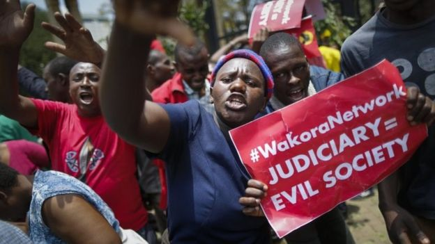 Supporters of the President Uhuru Kenyatta and his Jubilee party shout slogans to protest against the Supreme Court in downtown Nairobi, Kenya, 19 September 2017