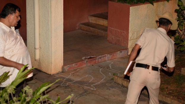 Police officials investigate the crime scene at the house of 55-year-old Gauri Lankesh