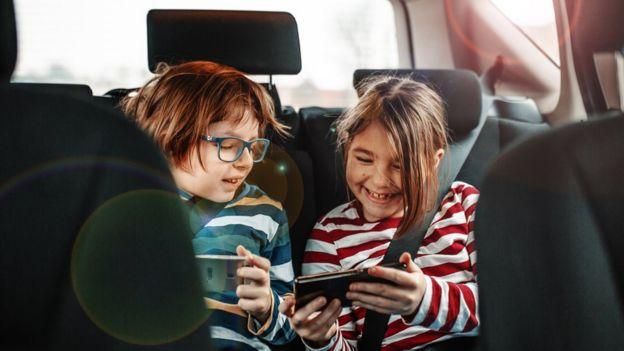 children using mobile phone