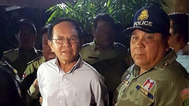 This file photo taken on September 3, 2017 shows Cambodian opposition leader Kem Sokha (L) being escorted by police at his home in Phnom Penh