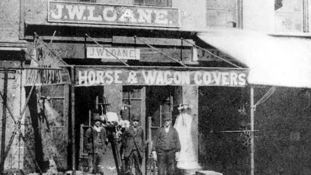Black and white photograph showing the first Loane Bros storefront in the 1800s