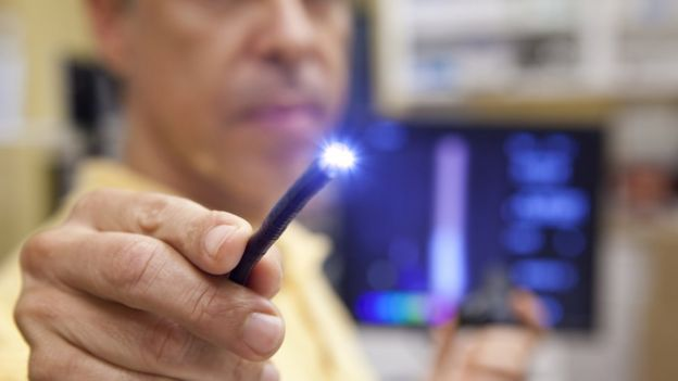 Doctor testing light probe used for endoscopy