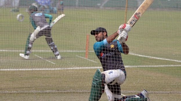 Pakistani cricket captain Sarfraz Ahmad (R) hits a shot during a practice session at the Gaddafi Cricket Stadium in Lahore on 8 September 2017, for the forthcoming World XI tour to Pakistan