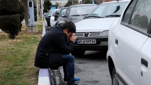 Grieving relatives at Mehrabad airport in Tehran following the Aseman air crash in which dozens are feared dead, 18 February