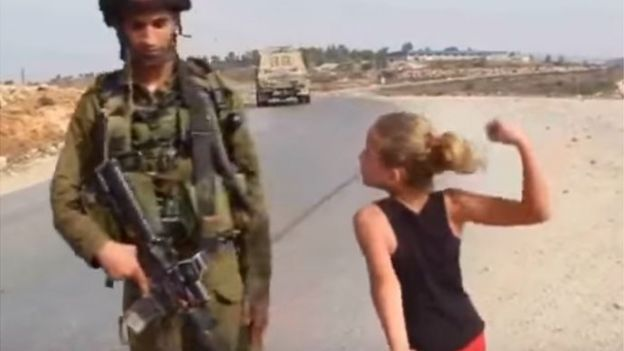 Still from video showing Ahed Tamimi threatening to punch an Israel soldier (2012)
