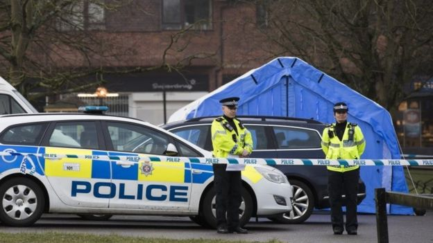 Police officers near a forensic tent in Salisbury