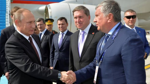 Russian President Vladimir Putin shakes hands with head of Russia's top oil producer Rosneft, Igor Sechin as he arrives at Ataturk airport in Istanbul, Turkey, October 10, 2016