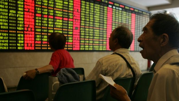 A man reacts amongst investors viewing stocks on a Chinese index