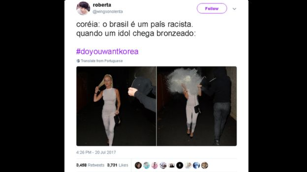 A picture of a woman getting a bucket of white paint dumped on her. The caption, in Portuguese, says: 'Korea: Brazil is a racist country. [But] when a celebrity who is tanned visits Korea ... '.