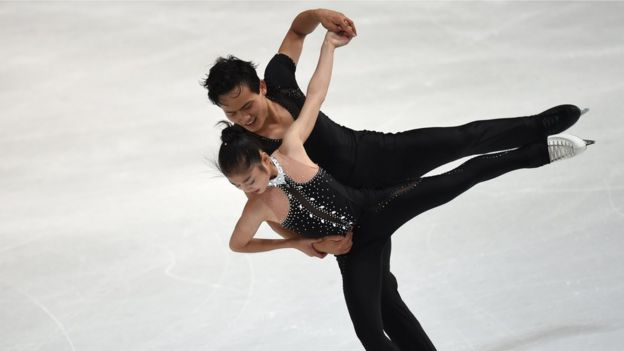 Ju Sik Kim and Tae Ok Ryom (L) of DPR Korea perform