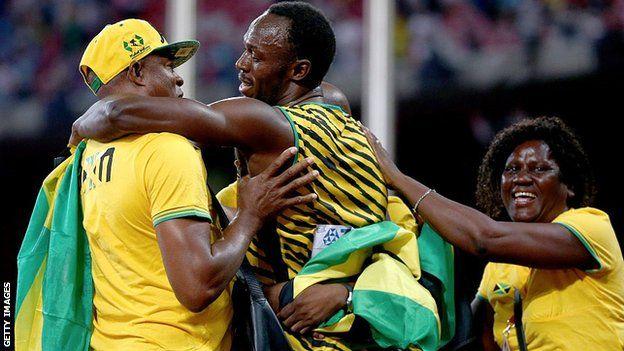 Usain Bolt e seus pais