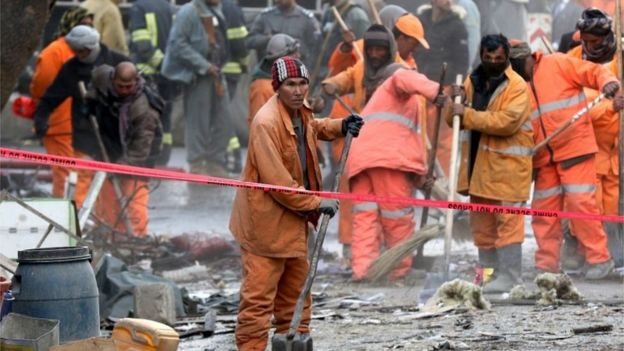 Municipal workers at the scene of the deadly attack in Kabul on January 27.
