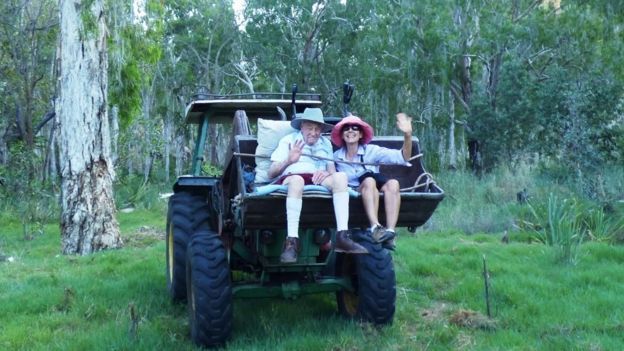 Dr David Goodall sits with relative on a tractor in Australia