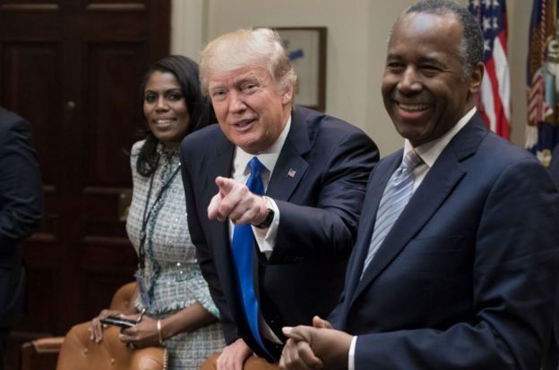 Mr Trump with Mrs Manigault and Housing Secretary Ben Carson