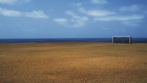 arco en campo y mar
