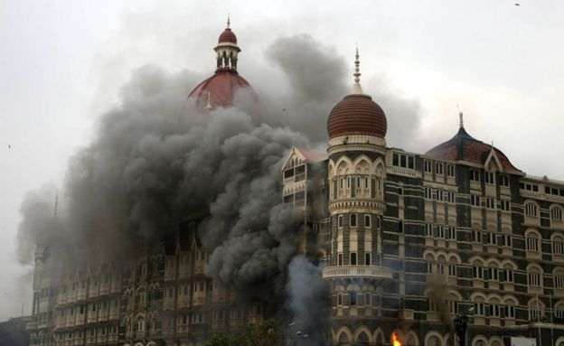 Smoke and flames billow out from The Taj Mahal hotel in Mumbai on November 29, 2008.