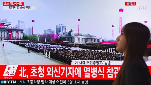 Footage of the ceremony to mark the 105th anniversary of the birth of North Korea's founder Kim Il-Sung is displayed on a TV screen at a railway station in Seoul, 15 April 2017