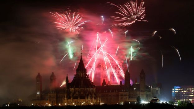 Fireworks explode over Ottawa's Parliament Hill as part of Canada Day celebrations in Gatineau, 2 July 2017