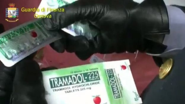 Italy's finance police display pills found in a consignment in Genoa (8 May)