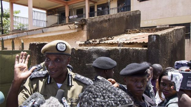 Ugandas Inspector General of Police, Kale Kayihura (L) addresses the press outside a building where five people were arrested in Kampala following a tip-off from local residents on April 7, 2015 suspecting them of alleged terrorist activity.