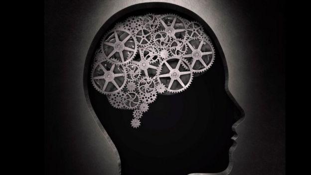 Una ilustración de un cerebro con unos engranajes