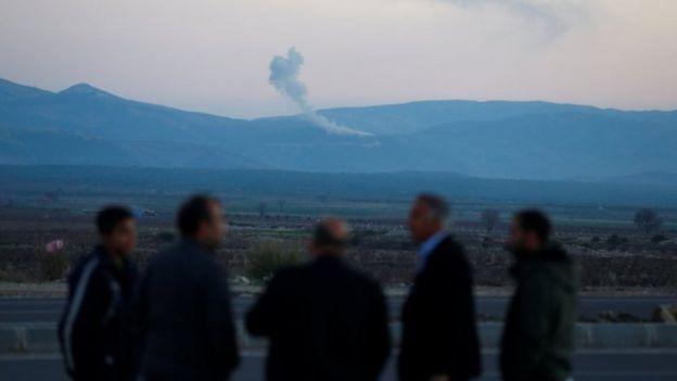 Smoke rises from the Syria's Afrin region, as it is pictured from near the Turkish town of Hassa, on the Turkish-Syrian border in Hatay province, Turkey on 20 January 2018