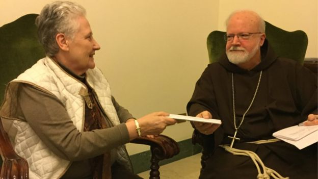 Marie Collins, a former member of the Pontifical Council on the Abuse of Minors, handing a letter to Cardinal Sean O'Malley, the Archbishop of Boston, 12 April 2015