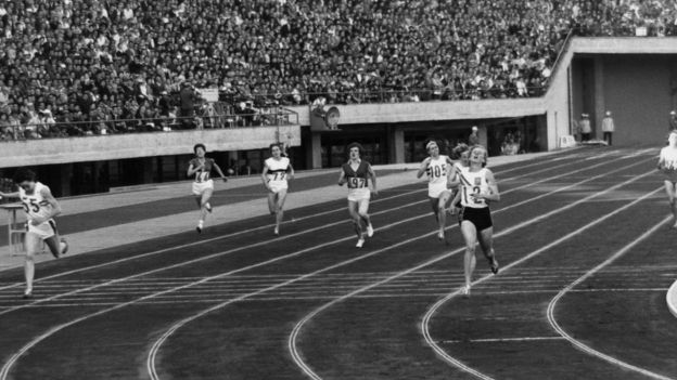 Betty Cuthbert crosses the finish line at the 400 metres final in the 1964 Tokyo Olympics