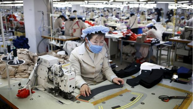 A North Korean employee works in a factory of a South Korean company at Kaesong