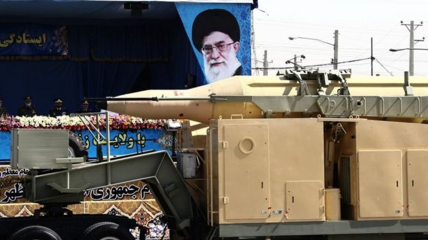 A military truck transports a medium-range Qadr missile in front of the image of the Iranian supreme leader, Ayatollah Ali Khamenei, during a parade in Tehran, September 22, 2014