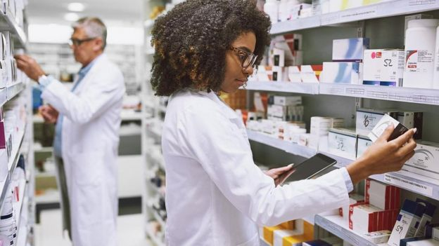 Workers in a pharmacy.
