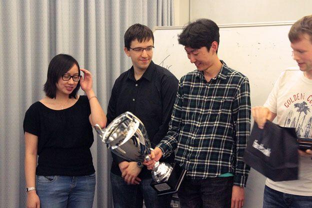 Winning team members Stella Lau, Will Shackleton, Cheng Sun, and Gábor Szarka.