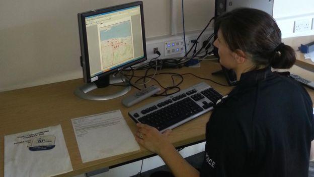 Policewoman on computer