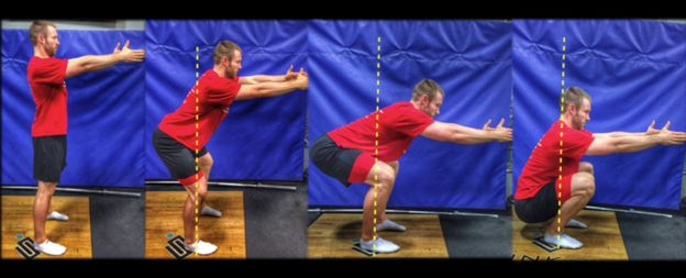 Dr. Aaron Horschig demonstrates the position of a correct squat.