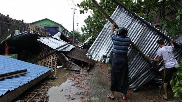 People clear debris from their house in Sittwe, Rakhine State, western Myanmar. Photo: 30 May 2017