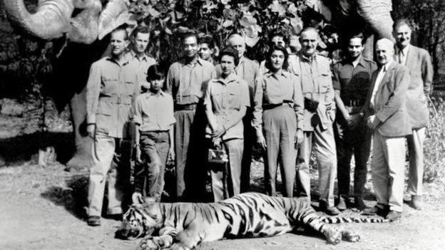 In this picture taken 26 January 1961 Britain's Queen Elizabeth (C) and Prince Philip (L) pose with the Maharaja (4L) and Maharani (5R) of Jaipur after a tiger shoot in Jaipur. The grandchildren of one of India's most famous former royals -- once one of the world's most beautiful women -- have dragged her to court demanding a share of the family fortune, a report said 28 July 2006