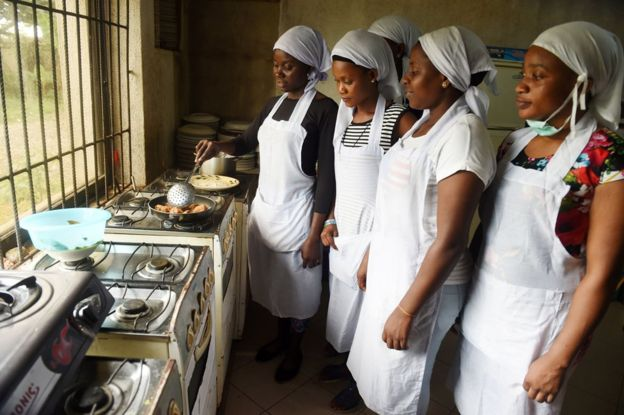 Women learn to cook at a non-governmental organisation in Benin, Nigeria