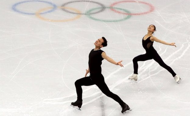 Figure skaters Ryom Tae-ok (R) and Kim Ju-sik of North Korea practice at Gangneung Ice Arena in Pyeongchang