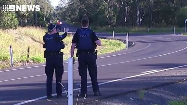 Queensland police officer shot dead, gunman on the run