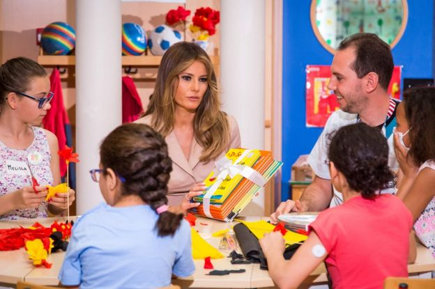 US First Lady Melania Trump (C) gives presents to patients as she visits the Queen Fabiola children's hospital in Brussels, 25 May
