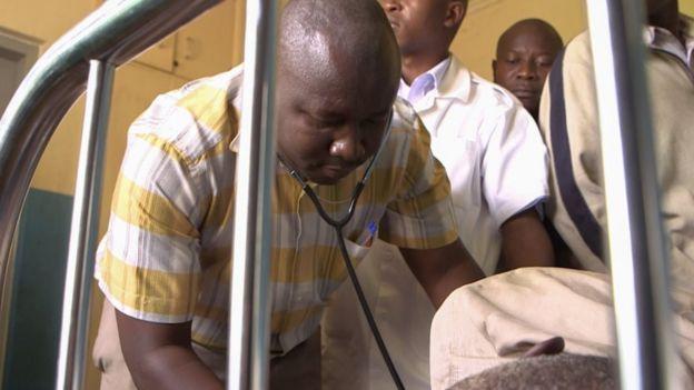 Dr Charles Waako treats a patient