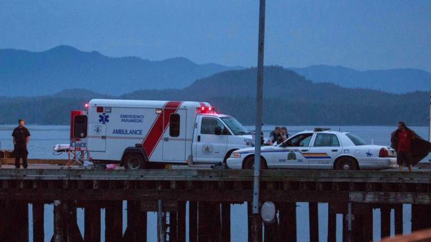 Rescue personnel mounting a search for victims of a capsized whale watching boat park on a wharf in Tofino, British Columbia October 25, 2015.