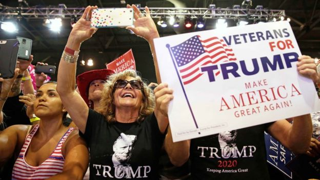 Supporters of U.S. President Donald Trump cheer him at a campaign rally in Phoenix, Arizona, U.S., August 22, 2017.
