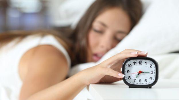 sleeping girl and alarm clock