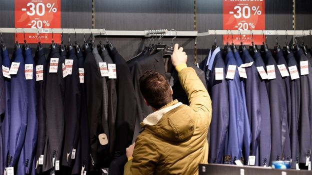 A man shops at a mall in Talange, eastern France, on the first day of the regional winter sales, on 2 January 2017