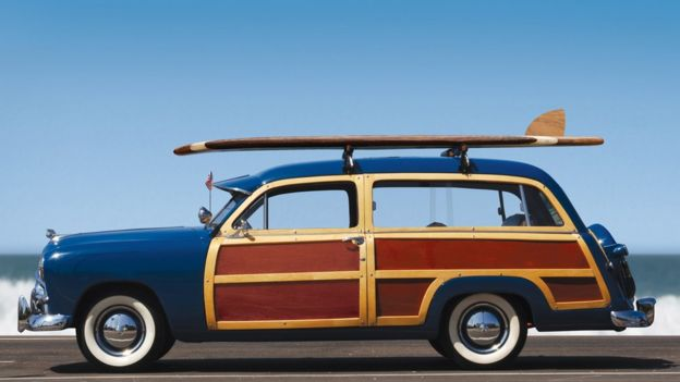 Old-fashioned car with wood doors and side panels
